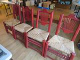 Four heavy rush seat chairs, red