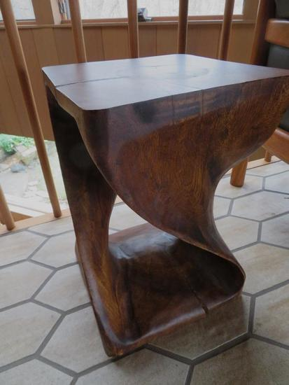 "Modernistic wood side table, 12"" top and 18"" tall"