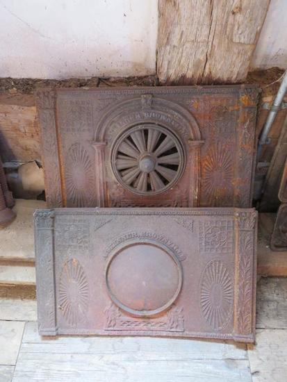 Ornate cast iron stove parts, two pieces