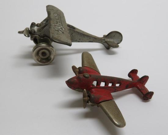 "Two Cast Iron airplanes, Arcade Monocoupe, 3"" and 4 1/2"""
