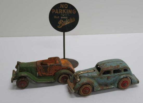 Two Cast Iron cars and No Parking Buick metal sign