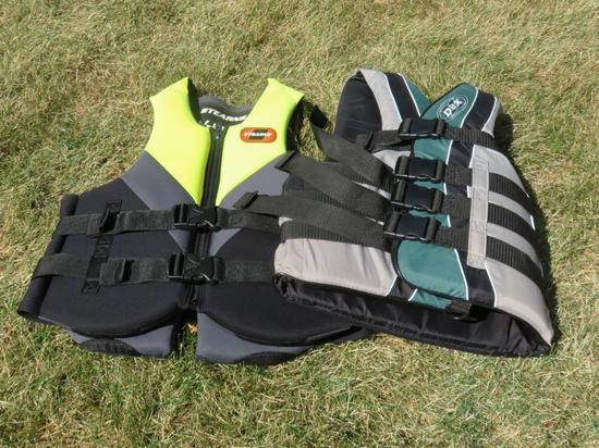 Stearns neoprene size large and small/medium DBX life vests