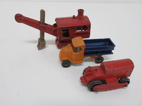 Three cast iron and Tootsie Toy commercial vehicles