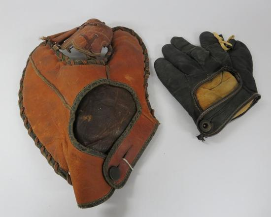 Two vintage baseball gloves, McKinnon and Winfield