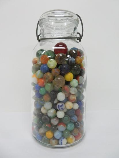 About 400 vintage marbles in old canning jar, machine made