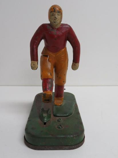 "Cast Iron Woolsey Mechanical Football Player, Kicker 21, 7 1/2"", c 1930's"