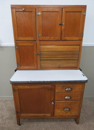 Oak Hoosier cabinet with flour bin and enamel top