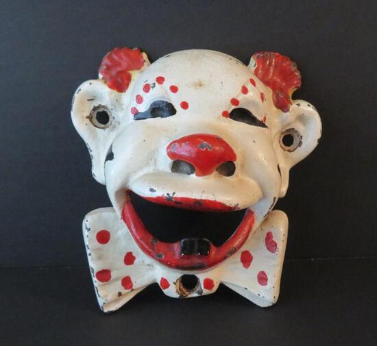 "Cast iron clown face can opener, 4"""