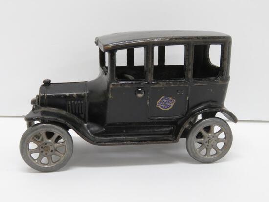 """Arcade cast iron car, 6 1/2"""", with foil tag"""