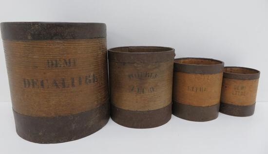 Four wooden nested measures, four pieces