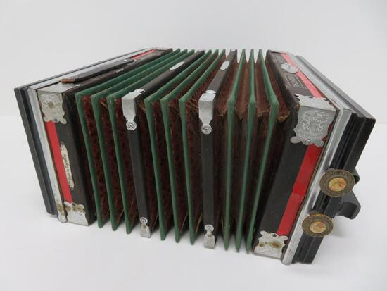 Universal Accordion, very ornate with inlay and celluloid portrait buttons