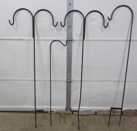 "Four metal shepherd hooks, plant hooks, 48"" and (3) 65"""