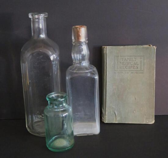 Three medicinal bottles and Family Medical recipes book