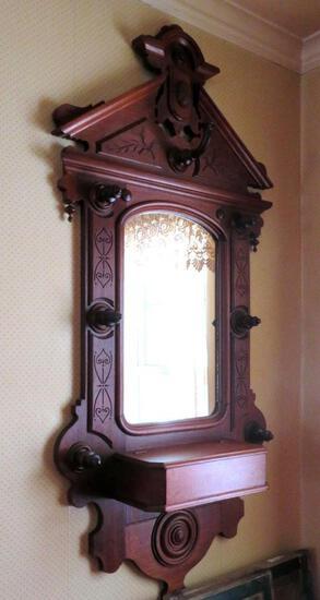 Ornately carved Walnut entry mirror with storage box