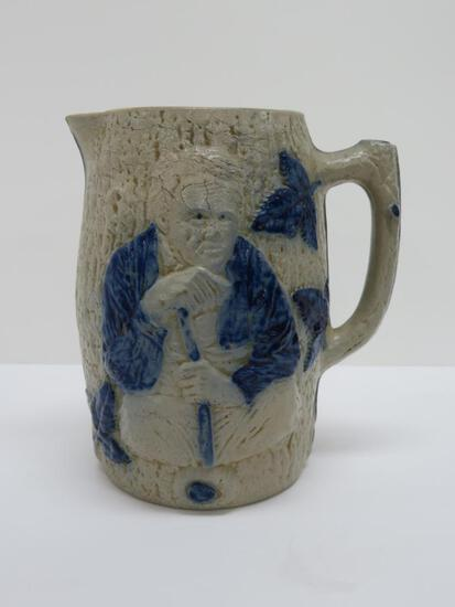 """Blue and Gray stoneware milk pitcher, man with stick by tree, 8 1/2"""""""