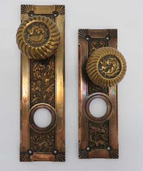 Two ornate bronze door knobs and back plates, gargoyles