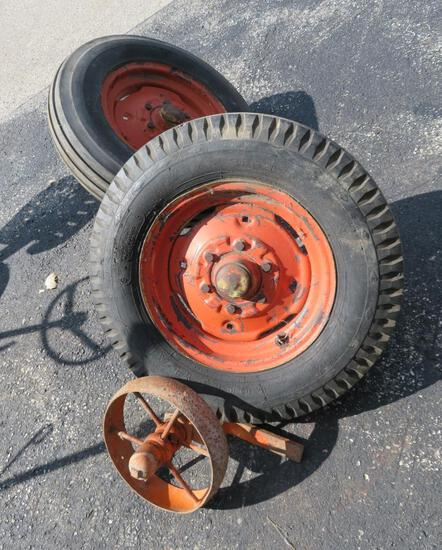 """Two implement or wagon tires 6.5 x 16 and 12"""" Cast iron wheel"""