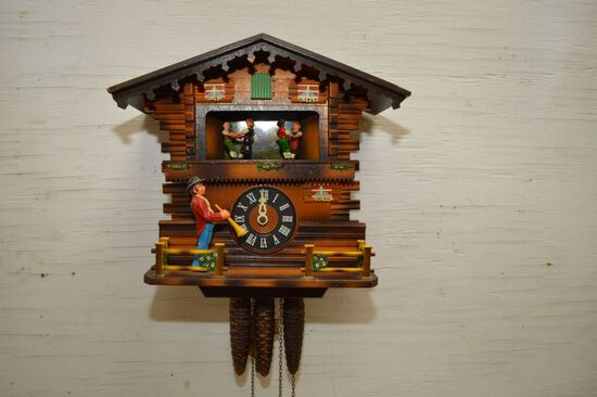 Plastic Face w/ Germany Cuckoo Clock w/ Dancers, Trumpeter and Bird had Pen