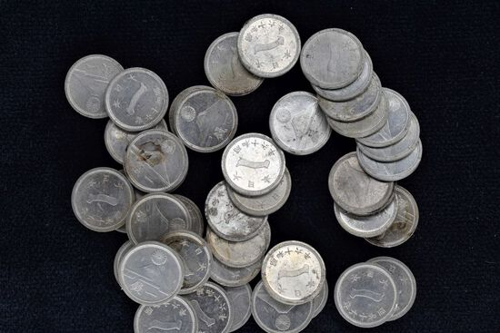 Approximately 40 World Coins