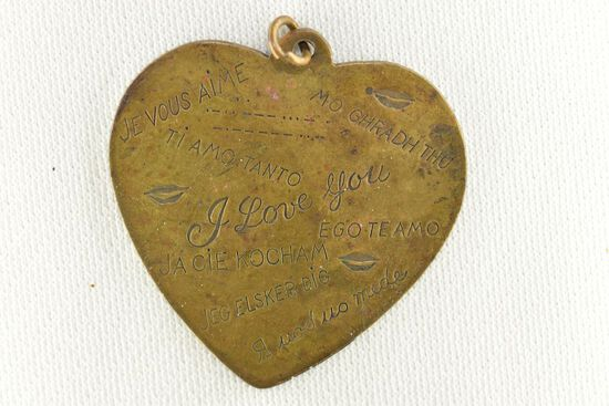 "Brass Heart Shaped Medallion as a Necklace Stamped with ""I Love You"" in Sev"