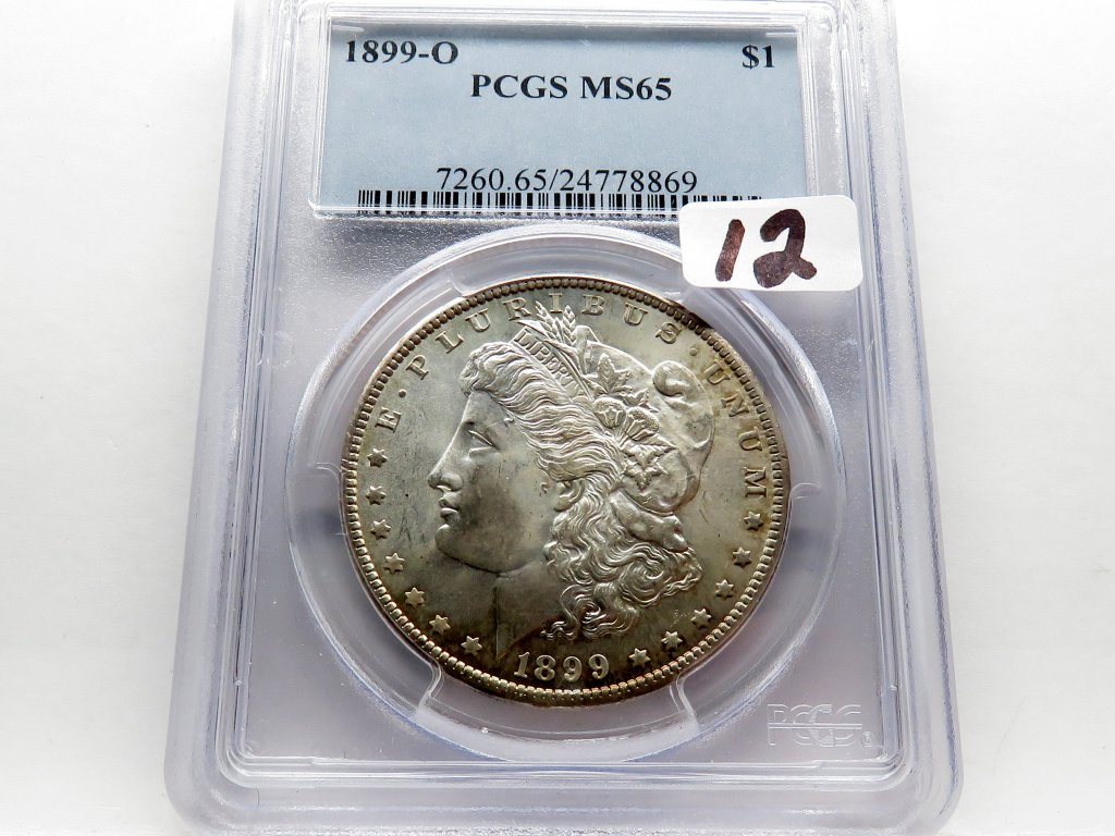 Morgan $ 1899-O PCGS MS65, toning