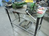 Work bench, vise, on casters.