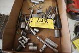 Assorted sockets, extensions, drill bits.