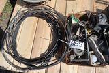 Horns, street light, cable.