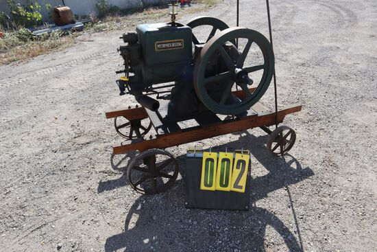 McCormick Deering gas engine, 3 hp, No. W14956, on steel wheel cart.