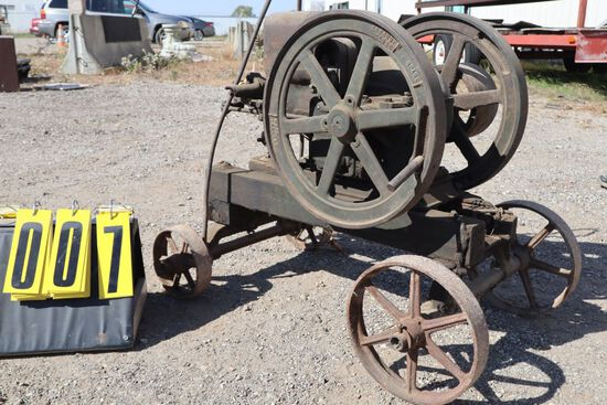 John Deere gas engine, Type E, 1 1/2 hp, No. 321398, on steel wheel truck.