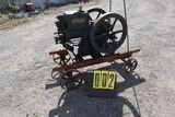 McCormick Deering gas engine, 3 hp, No. W14956, on steel wheel cart.