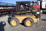 New Holland LX665 skidloader, sn 70481, hours on meter 920, OROPS cab, aux.