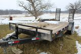 HP trailer flatbed truck with ramps.