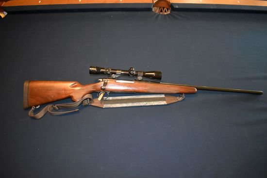 Remington Model 700, 7MM Rem Mag, Bolt Action, Top Load, Checkered Stock, Sling, With Redfield 3x9 S