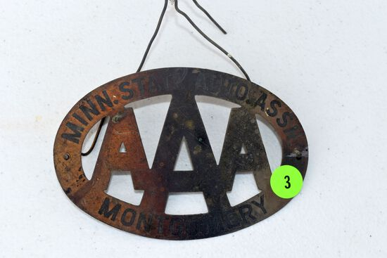 AAA brass badge