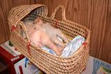 Wicker bassinet and dolls