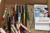 Assortment of bullet, mechanical pencils, pens, advertising booklets