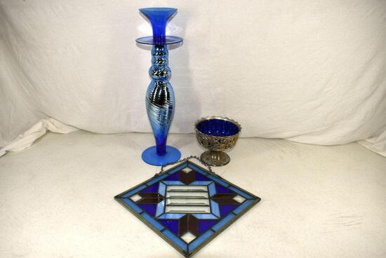 Assortment of blue glass and stain glass picture