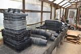large assortment of plastic planter pots, located in Building 94