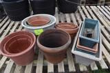 Assorted plastic and terracotta pots , located in GH 9
