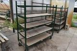 Metal rolling 5 tier shelf unit , located in Building 94