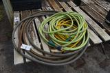 Assortment of garden hose , located in GH 24