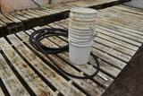 Garden hose and 5 gallon pales, located in GH 71