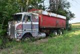 White Freightliner cab over tandem axle grain truck, 18' steel box & hoist, non running for