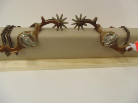 PAIR OF STAR MARKED BRASS SPURS WITH HORSEHEAD