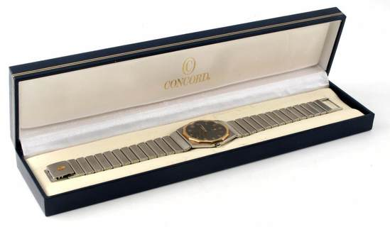 CONCORD MARINER STAINLESS STEEL GOLD BEVEL WATCH