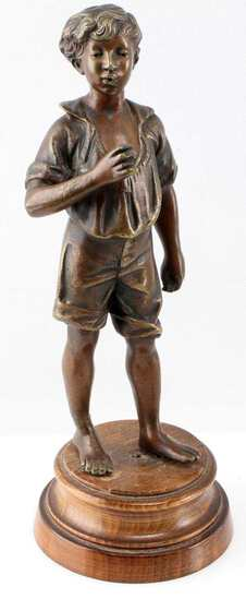 SMALL CAST BRONZE SCULPTURE OF LITTLE BOY