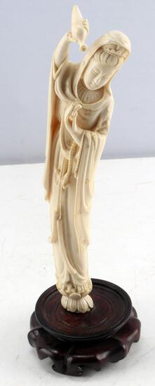 ANTIQUE IVORY FEMALE DEITY POURING FROM VESSEL