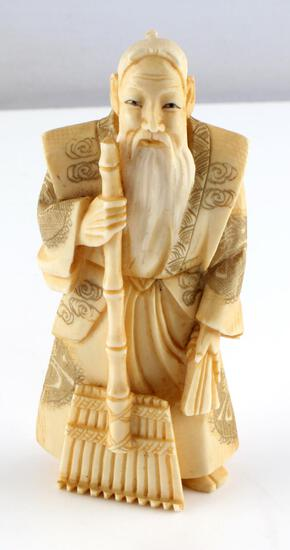 MEIJI PERIOD SCULPTED IVORY OKIMONO MALE FIGURE