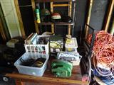 Misc items on rolling table-electric winch, records, cassette tapes, seat covers, helmets